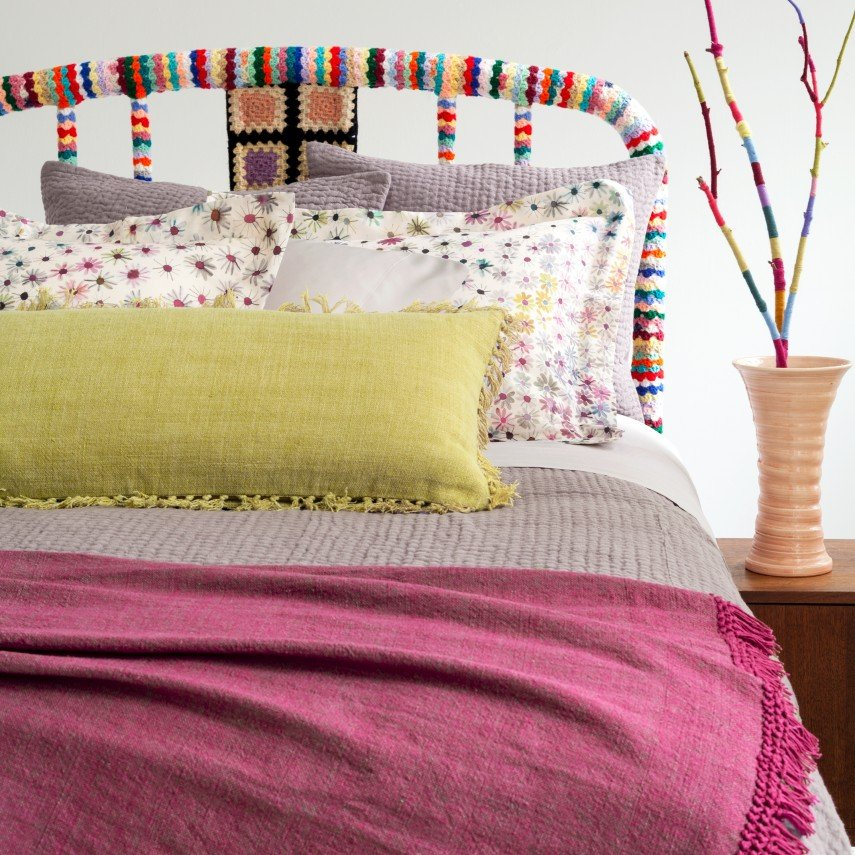 What fun - crochet covering an old headboard with yard sale finds.