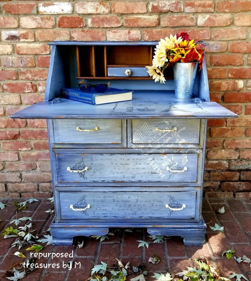 A writing desk, decked out with cursive writing and postal marks