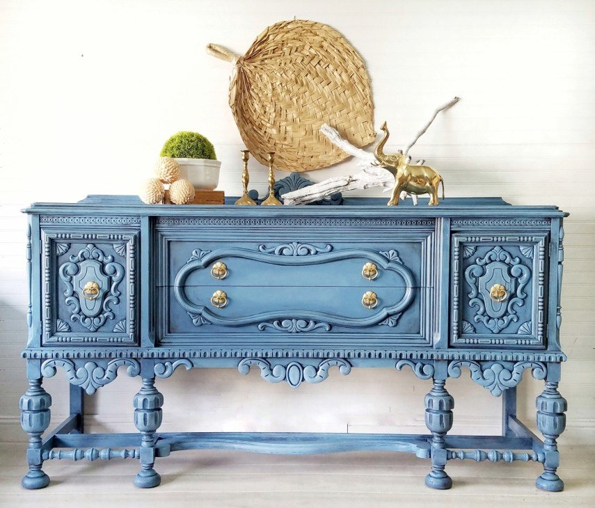 An ornate piece of blue hand painted furniture