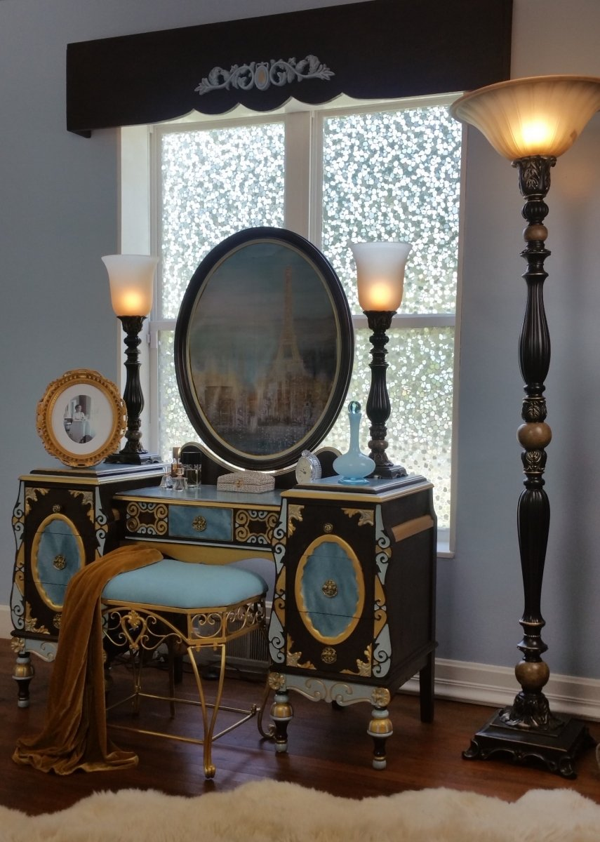 This decorative piece is an antique vanity.