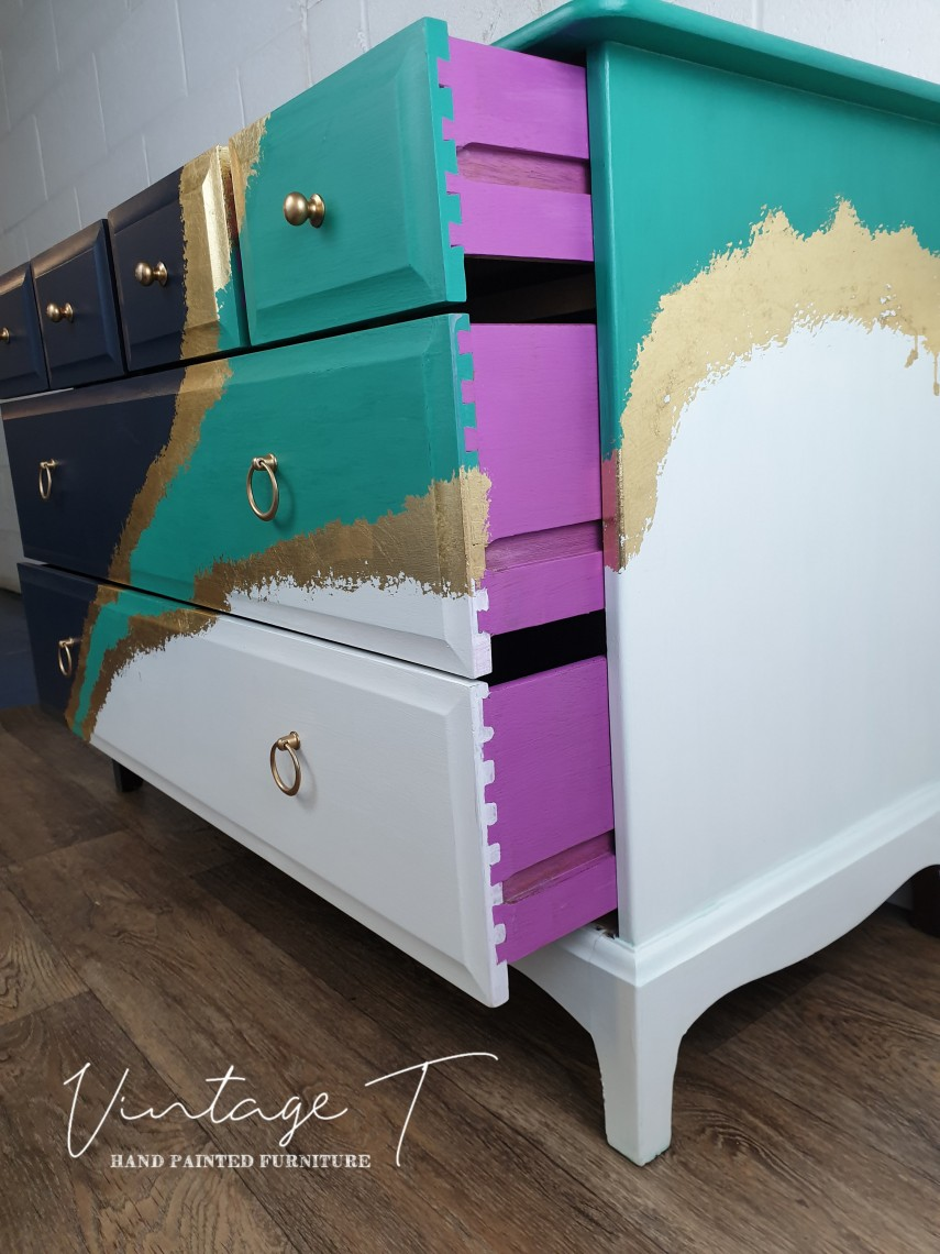 And the interior drawer walls are purple!