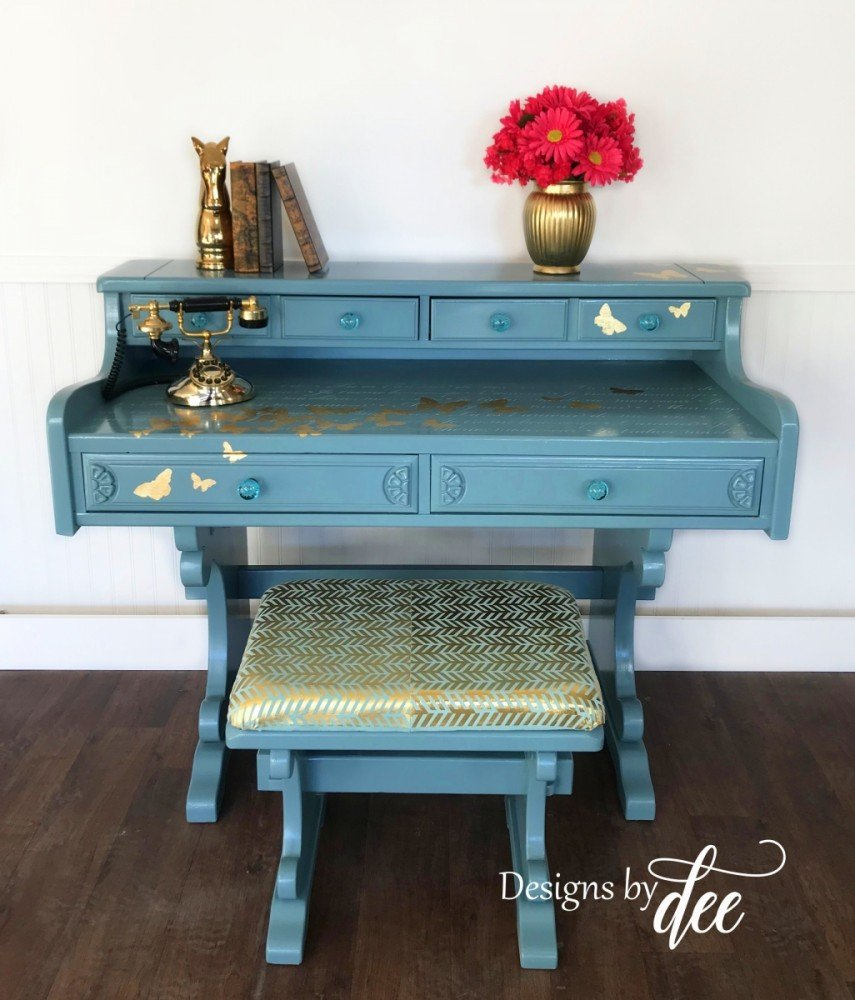 Blue painted furniture with gold accents