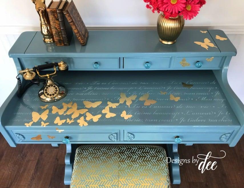 Gold butterflies highlight this custom painted desk