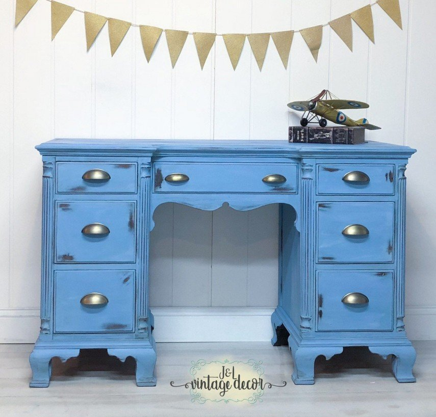 An old desk is updated with blue paint and new hardware
