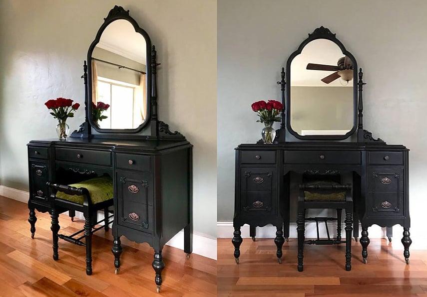 A vintage vanity table painted in black really pops against a wood floor