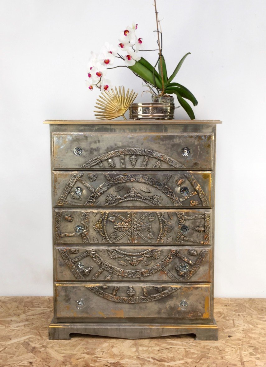 Silver, gold and crystal handles all work together in this decorative chest
