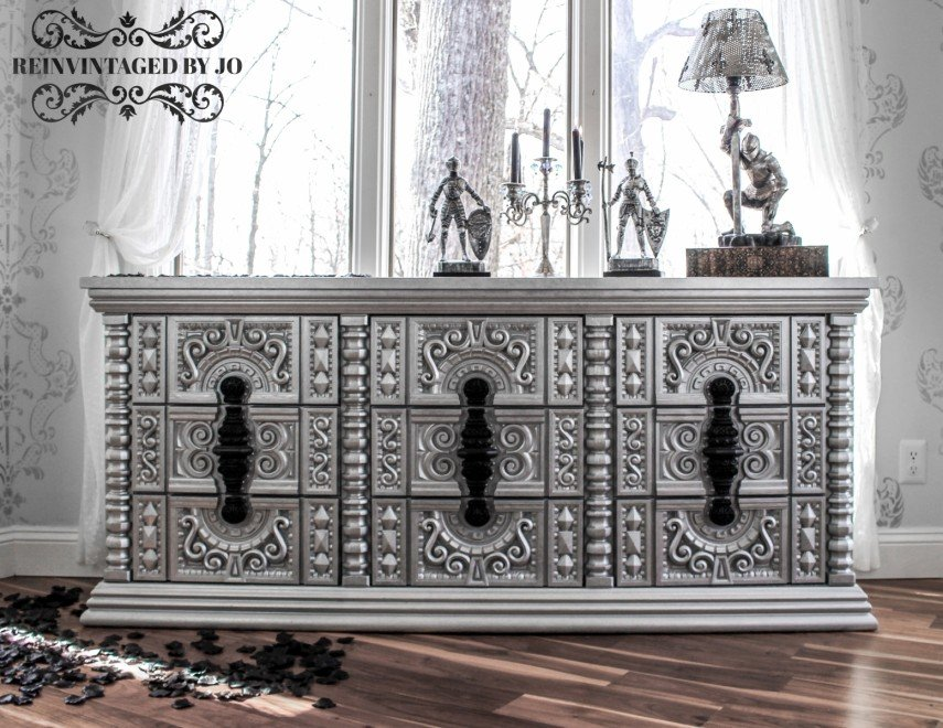 Black handles are a real stand out on this piece of vintage painted furniture