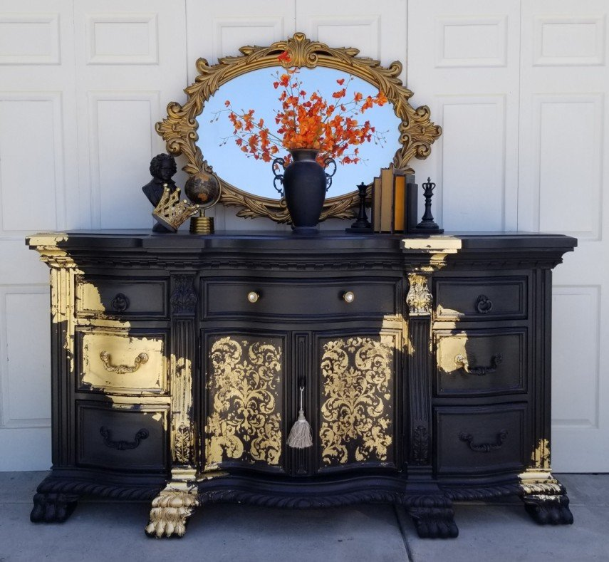 Again, gold swaths decorate this antique furniture piece - check out the feet!