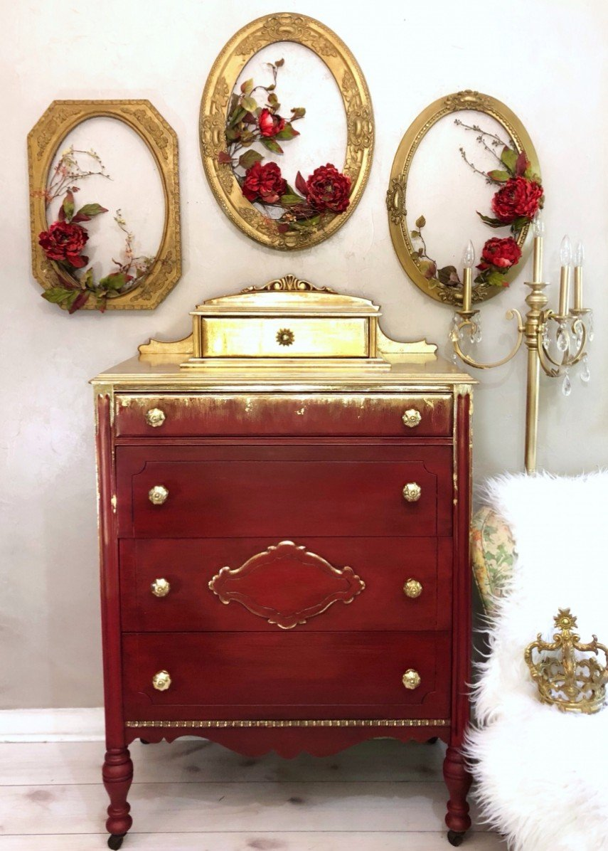 A unique use of gold - it looks great on the red dresser