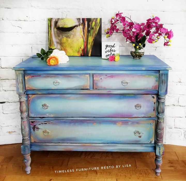 This rainbow painted dresser is Shabby Chic at its finest