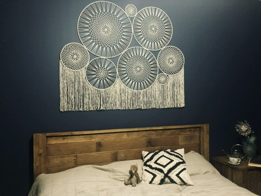 We love the fine lace look of this wall hanging headboard.