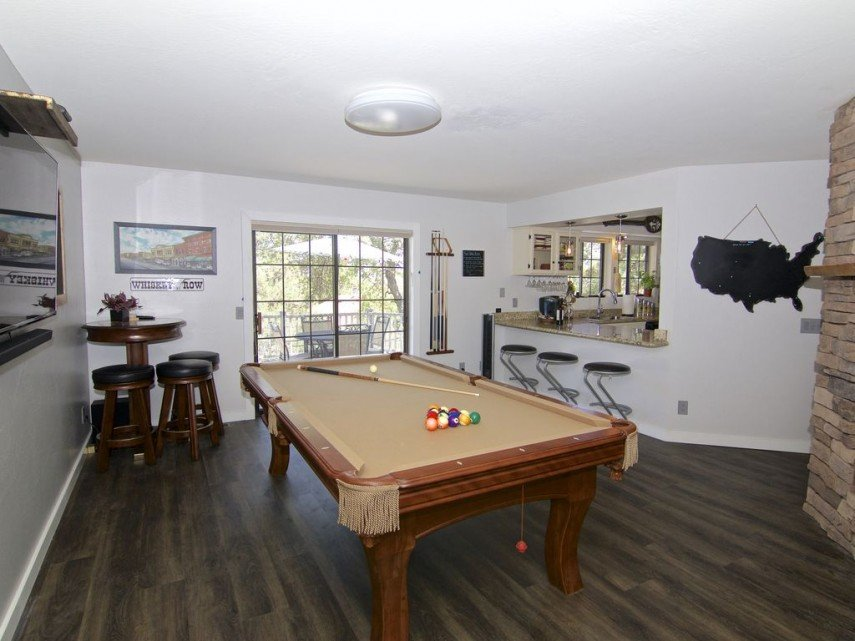 This dining room can seat six, bar style, and still leave room for a pool table