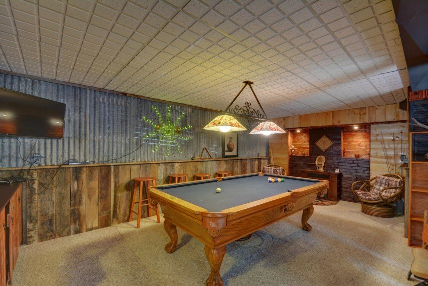 A great farmhouse design with galvanized metal and wood - and a pool table