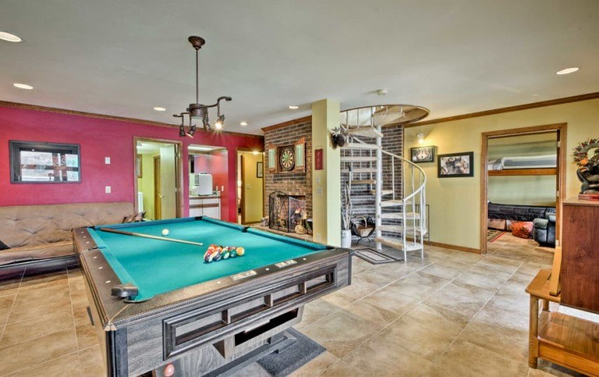 This billiards room decor incorporates unusual lighting