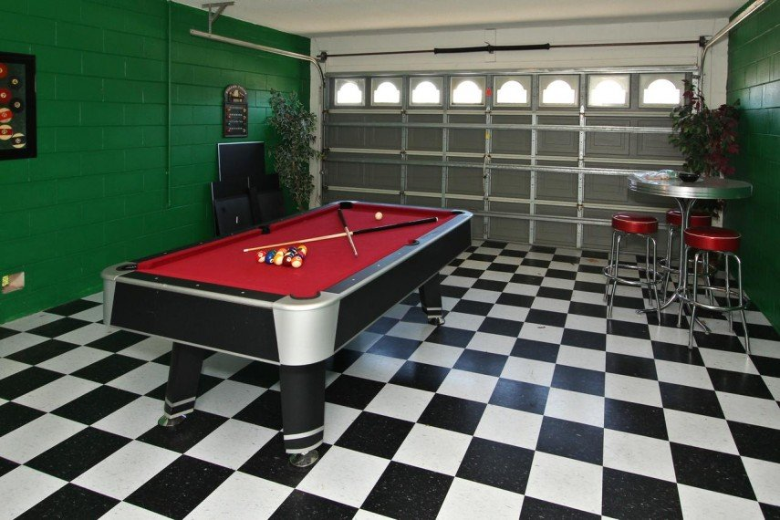 Another clever garage turned pool room - the black and white tiles are awesome - classic vintage soda fountain design
