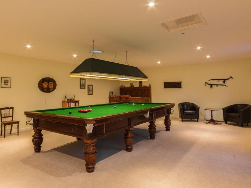 Classic billiards decor - the fringed light and heavy pool table