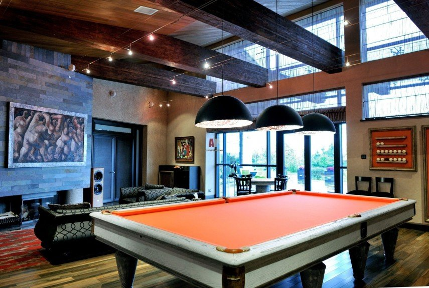 A modern decor billiards room with lots of light