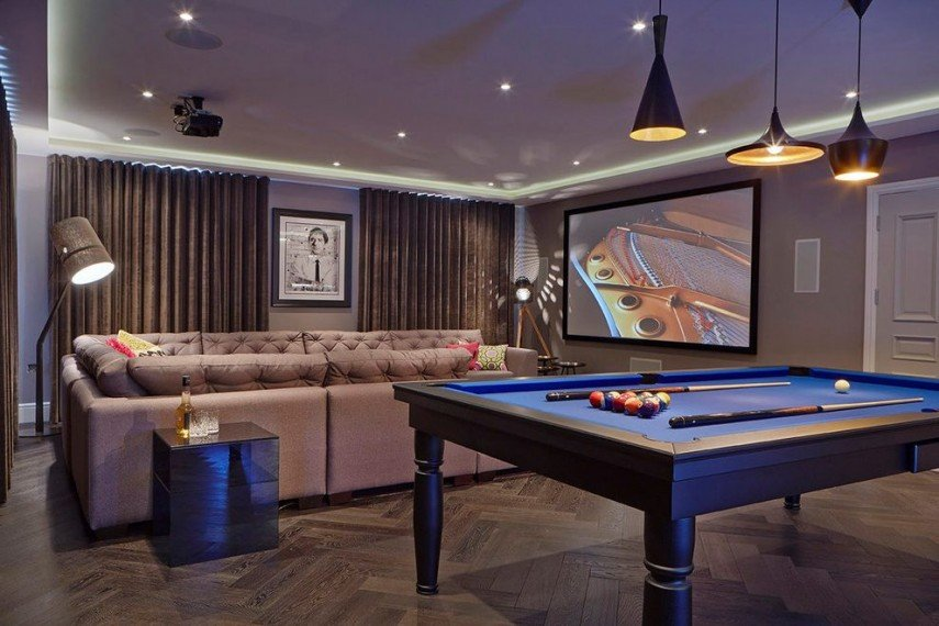 It's a less obvious pool room with such understated decor (love the lighting)