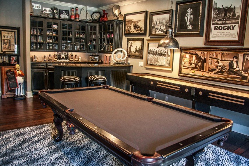An upscale bar and pool room - lots of interesting cultural decor