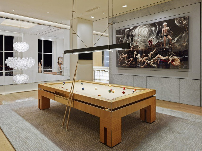 Here's a billiards room where the rug works very well with the decor