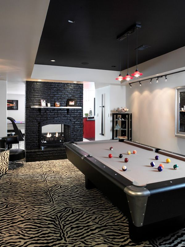 A fireplace always adds something to billiards room design