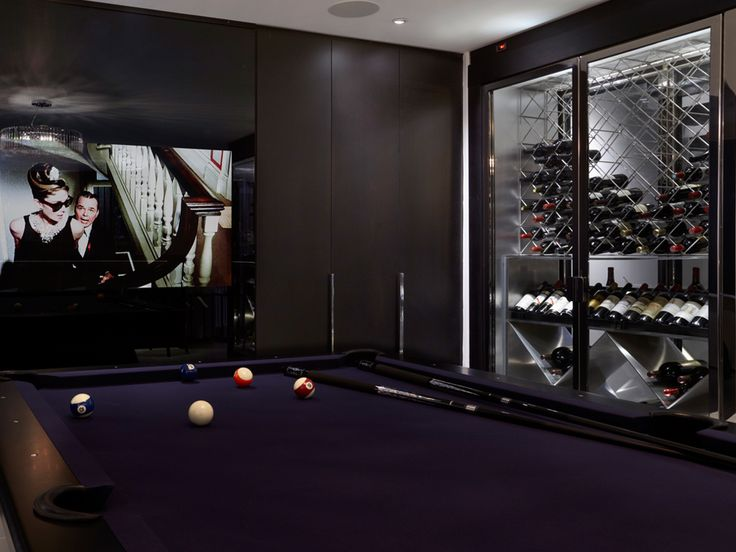 Another wine cellar in the billiards room and a giant wall of Breakfast at Tiffany's