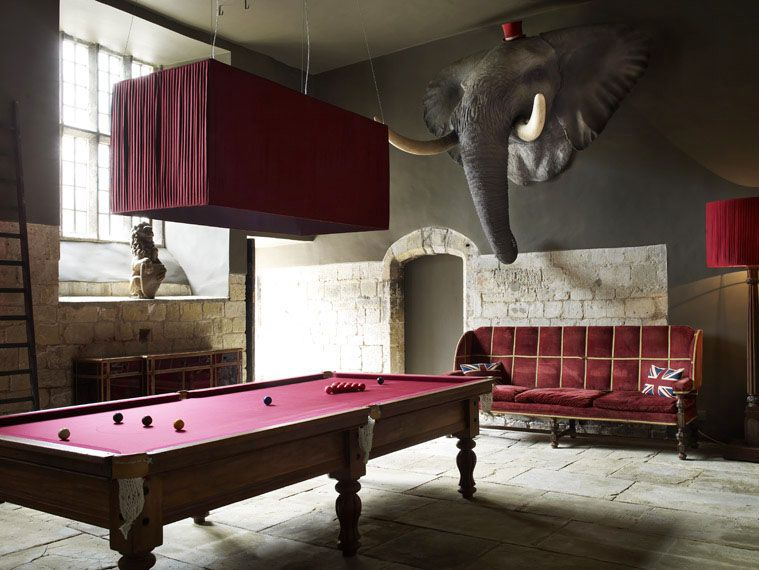 You can see how coordinating the color of the lighting and furniture with the pool table elevates the design