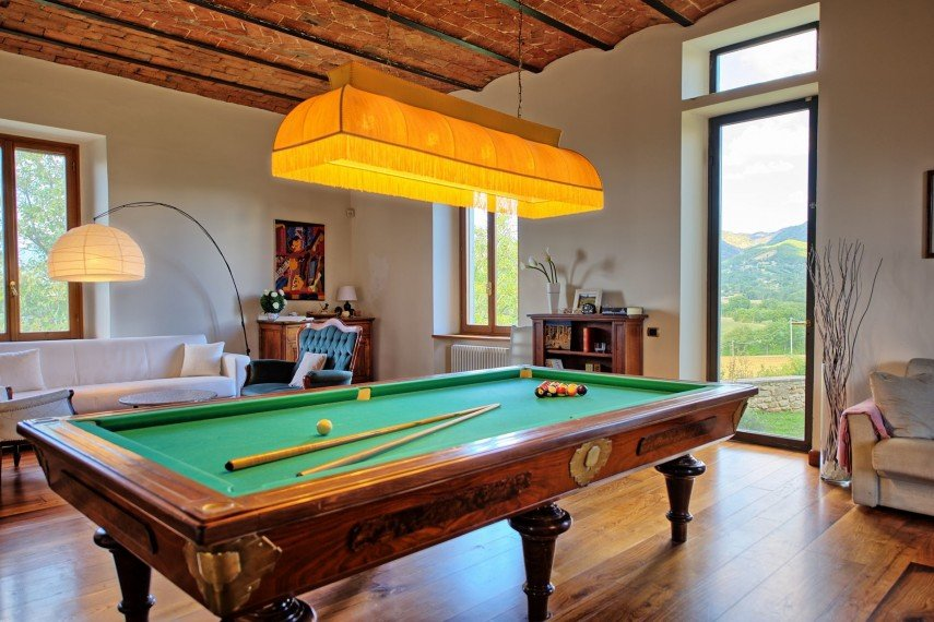 Another classic pool table lamp with fringes - and lots of natural light in this billiards room as well