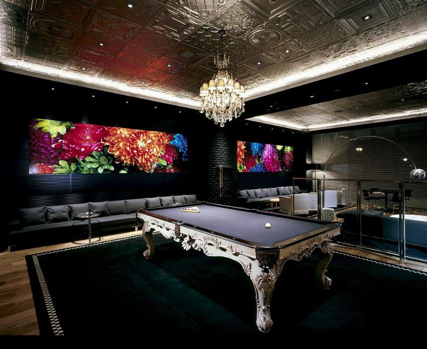 This chandelier is the most unusual pool table lighting that we've seen yet