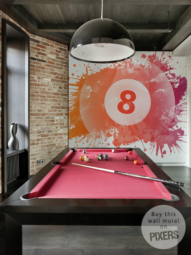 The eight ball on the wall totally changes the design of this pool table room