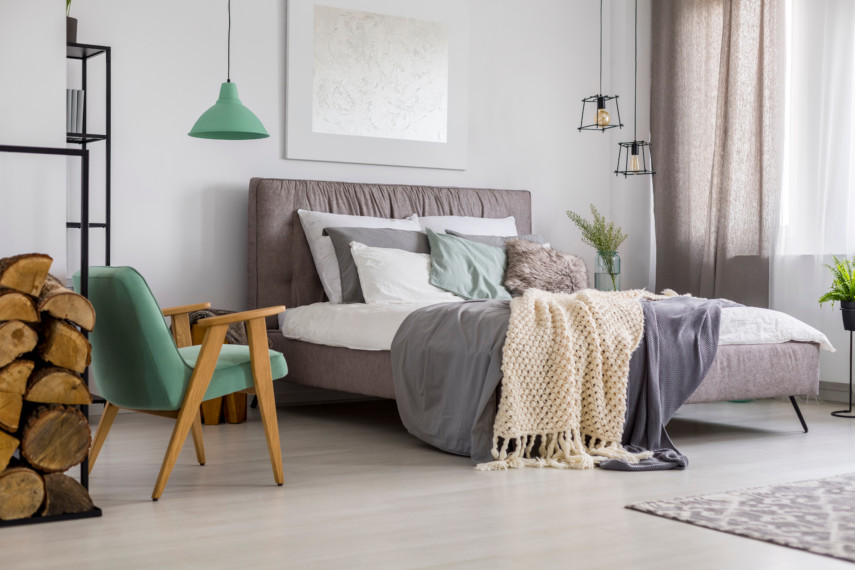 Light toned bedroom with simple teal accents