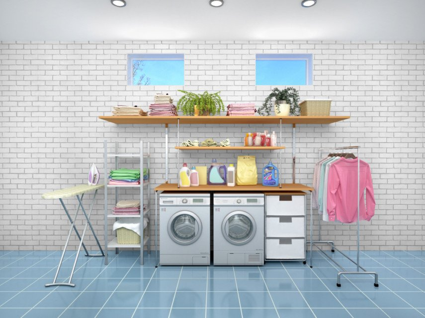 Laundry room layout against white brick wall contrasts with blue tile floor