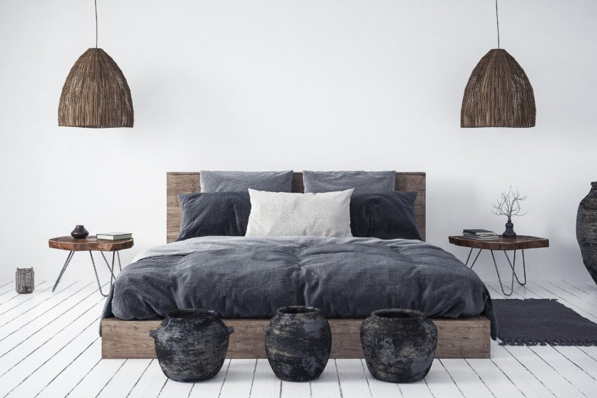 Bedroom with dark furniture and gray tone blankets