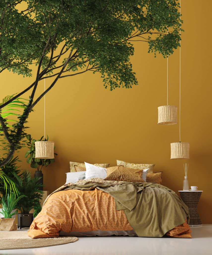 Warm toned bedroom with a small tree and hanging lanterns