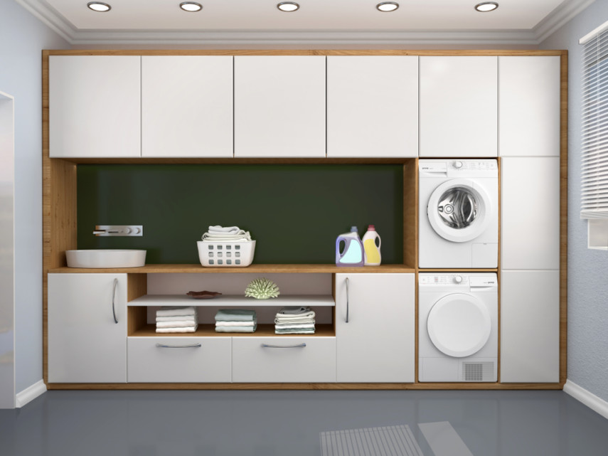 Recessed light fixtures, stacked washer and dryer, tiled floor makes good laundry layout design