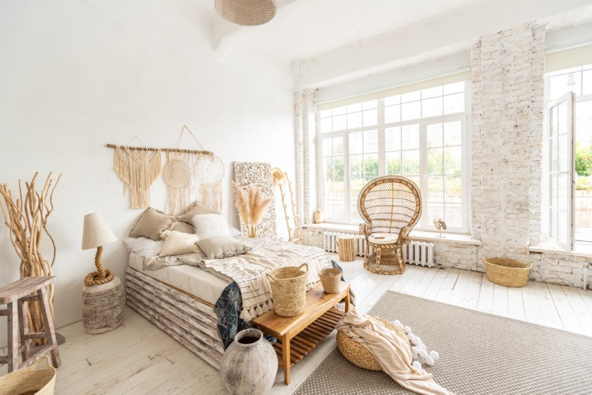 Airy neutral tone bedroom with large windows
