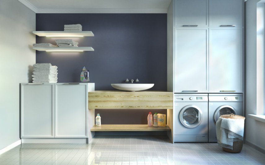 Add a laundry room to a chic bathroom by installing high-end decor elements such as a pedestal sink