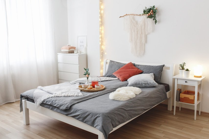Gray and white bedroom with breakfast tray