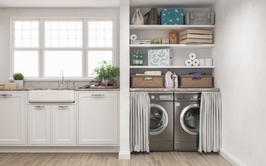 Enclosed laundry space design in kitchen with side-by-side machines hidden by curtains