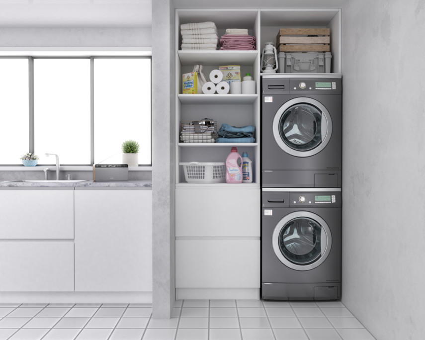 Organize a small spaces laundry room with open shelves, utility drawers and stacked machines