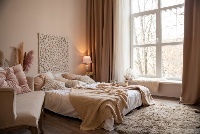 Warm toned bedroom with large windows