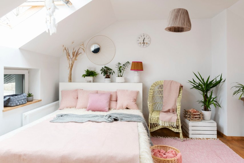 Pink toned bedroom with plants