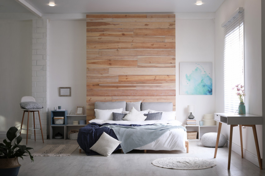 Simple toned bedroom with large wooden wallboard accent