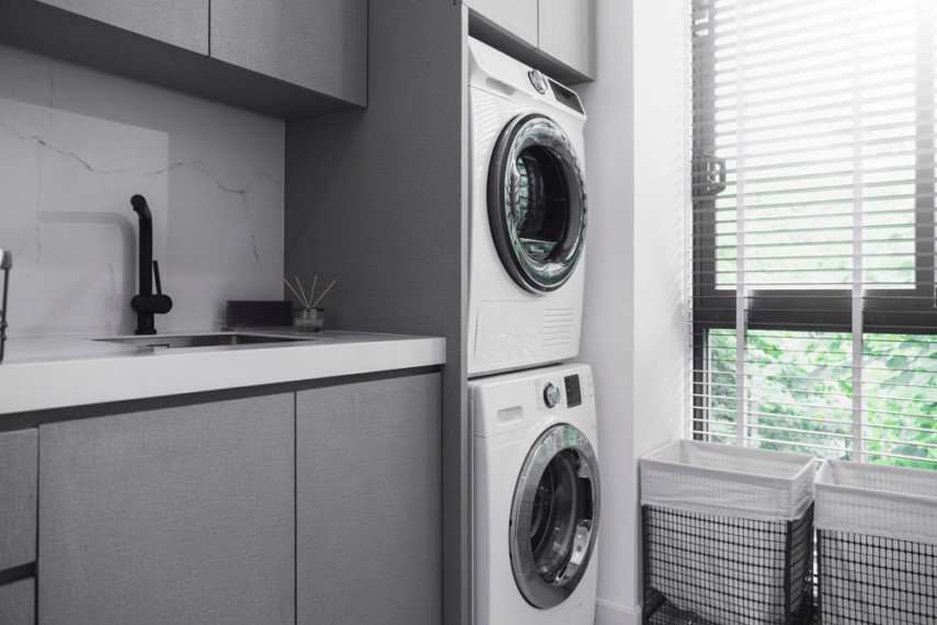 Install cabinets over a stacked washer and dryer