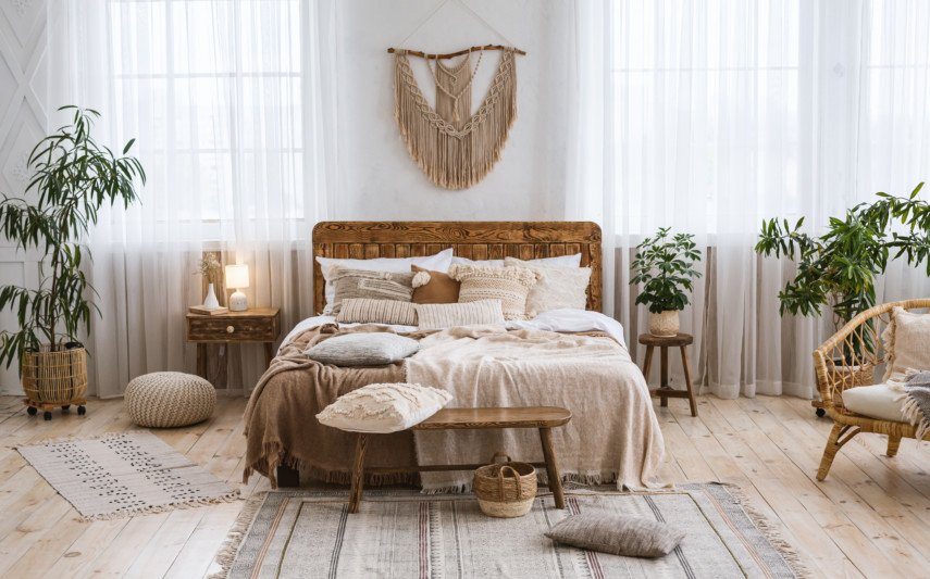 Earth tone bedroom filled with plants