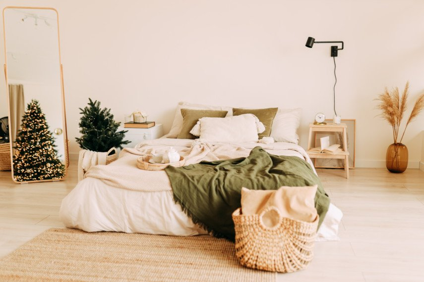 Earth tone bedroom with Christmas tree and basket