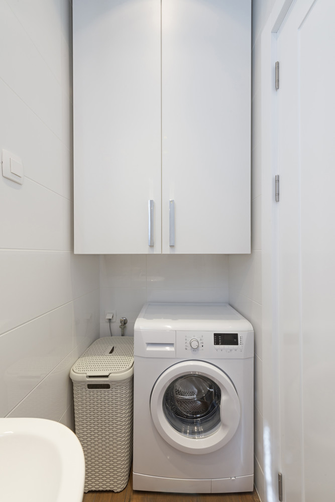 Small space laundry room inlcudes all-in-one washer dryer combo