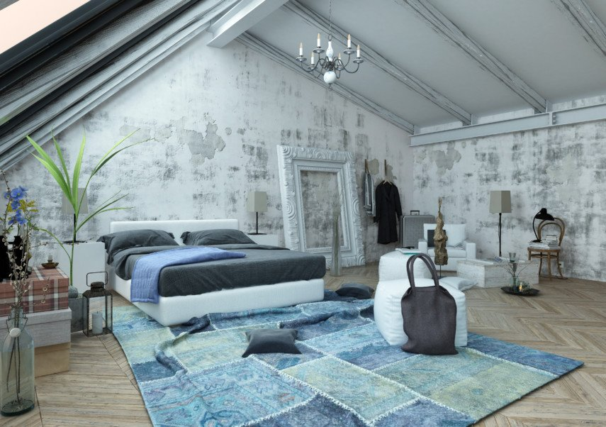 Blue and gray toned bedroom with large velvet carpet