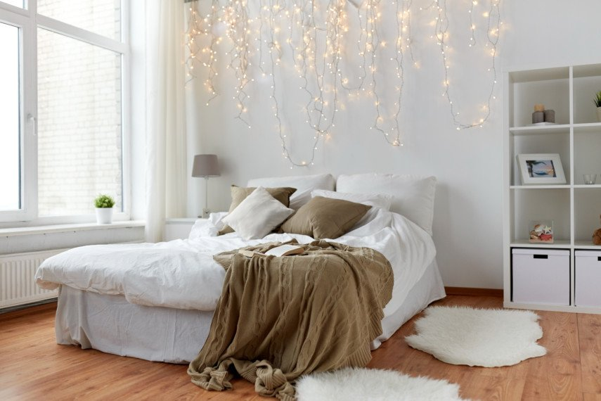 Cozy bedroom with fur rugs and string lights