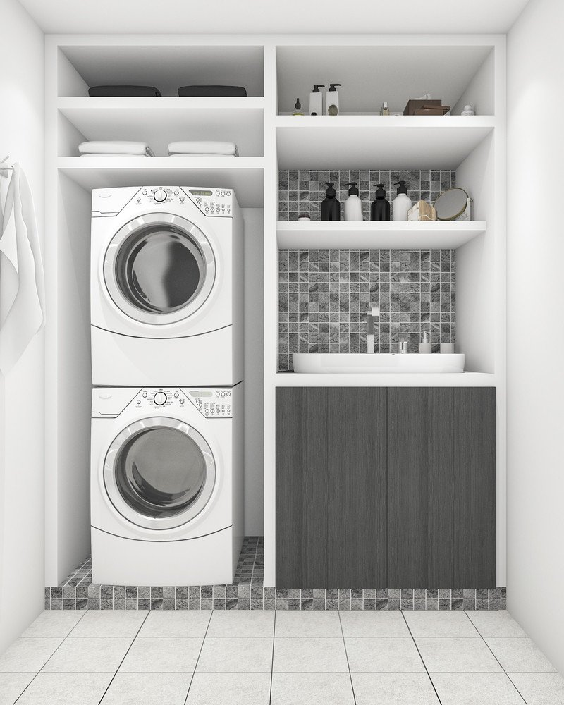 Versatile space space laundry room with stacked machines and open shelving